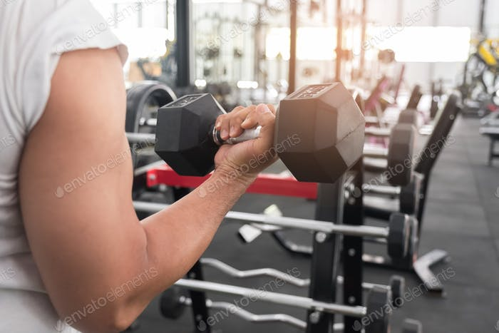 Men are lifting dumbbells,Photo from the back.
