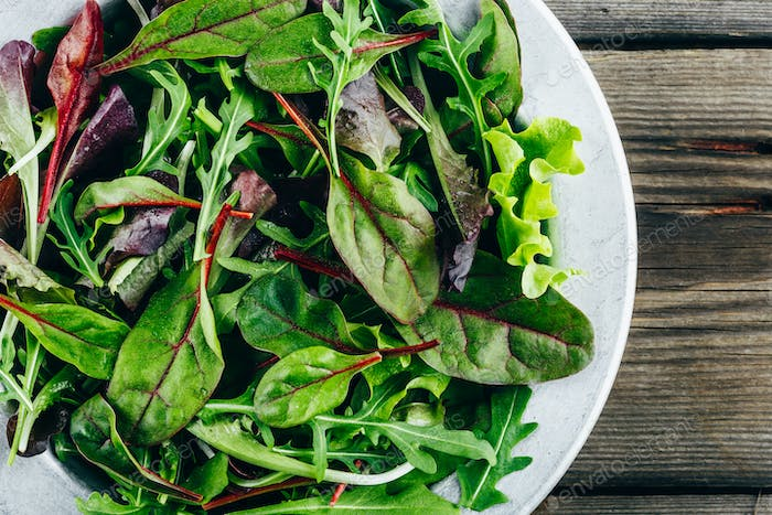 Mix of fresh green salad leaves with arugula, lettuce, spinach and beets