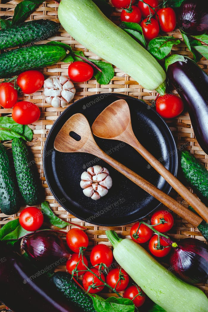 Various fresh vegetables on a rattan background