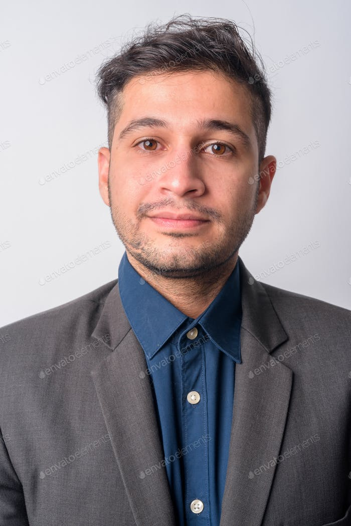 Face of young Persian businessman in suit