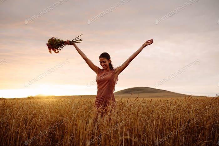 Woman enjoying a day in wheat field