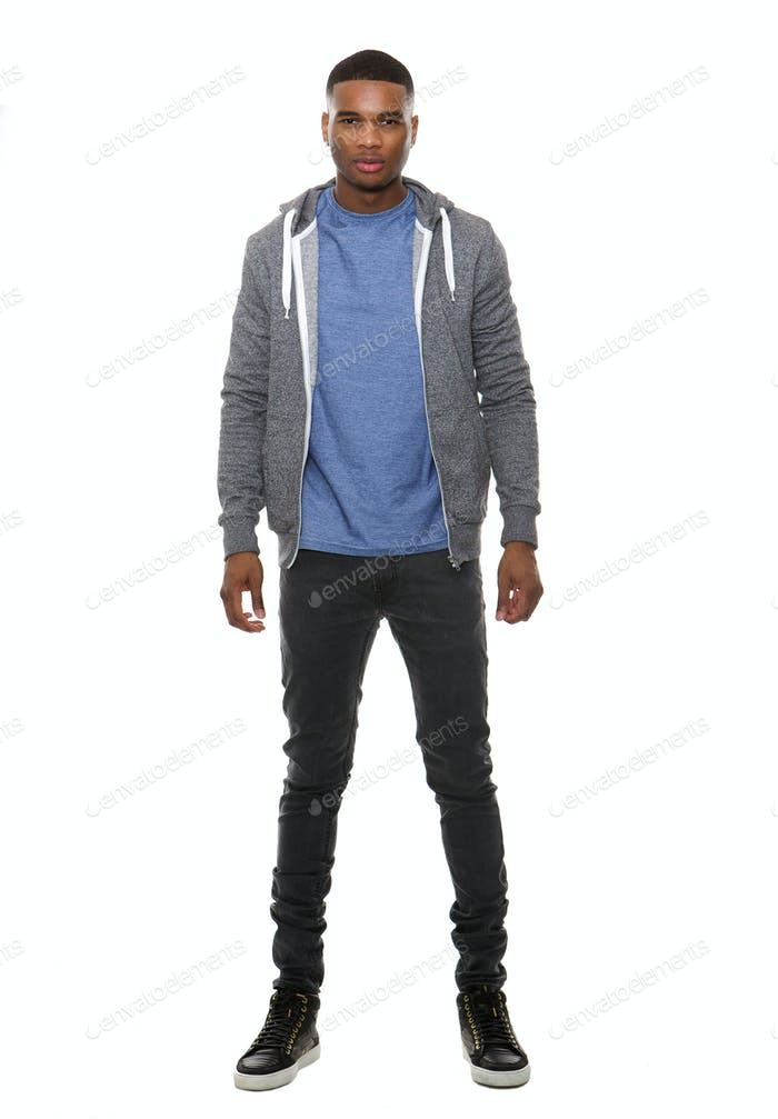 Young black male posing in sweatshirt and jeans