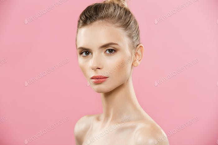 Beauty Concept - Beautiful Woman with Clean Fresh Skin close up on pink studio. Skin care face