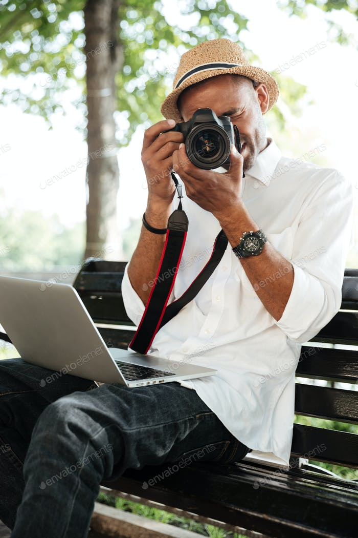 Hipster makes photo in park