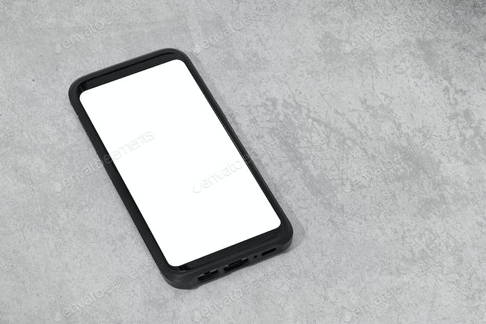Smart phone with white screen isolated on textured concrete background