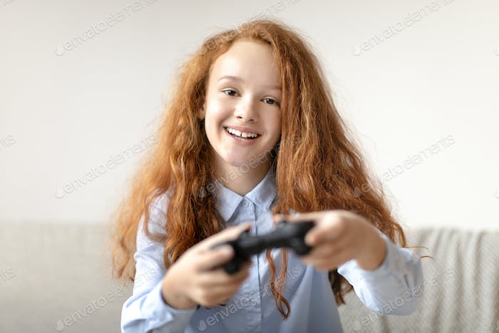 Young girl playing a video game with controller