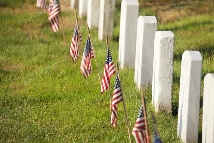 American Flags Near Gravestones at Arlington National Cemetery