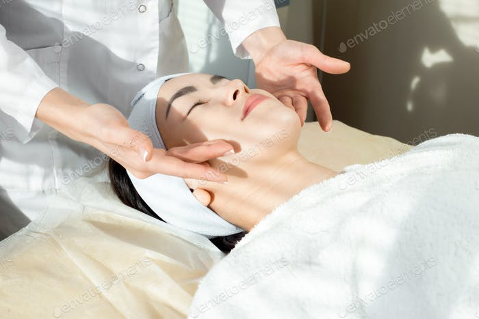 Young Asian Woman Enjoying Face Massage