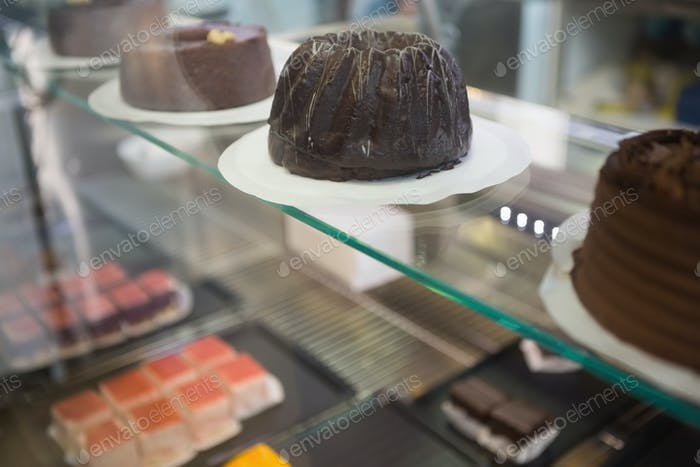 Display of fresh brownies and chocolate cakes at the bakery
