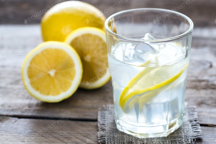 Glass of water with fresh lemon juice