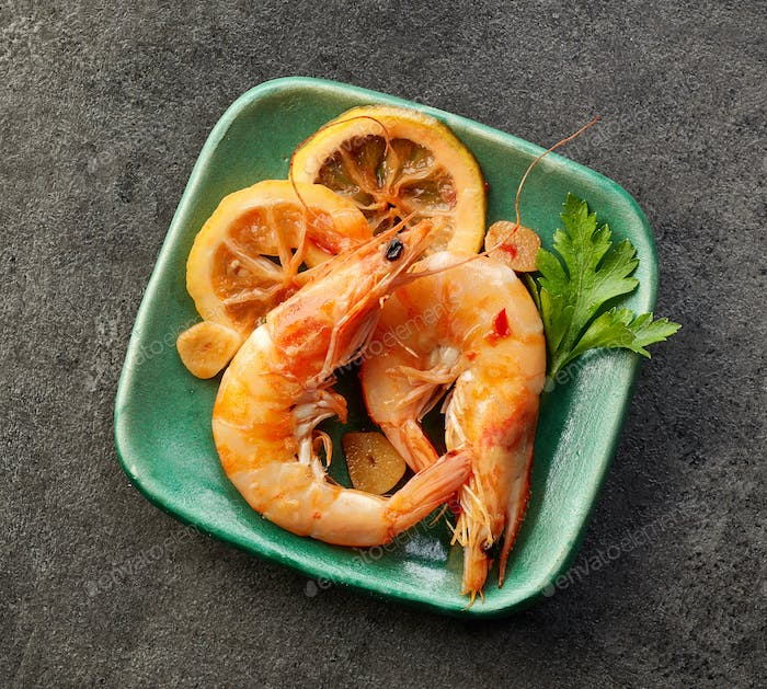 roasted prawns on green plate