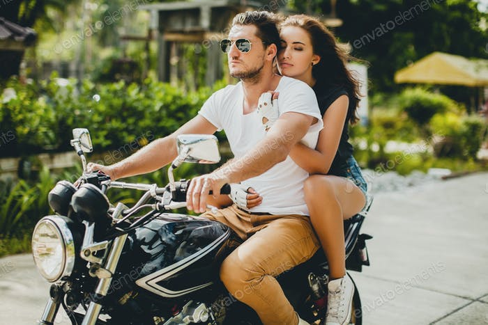 young couple in love, riding a motorcycle, hug, passion, free spirit