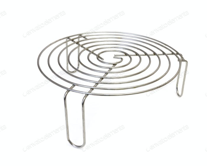 Metal trivet for hot tableware isolated on white background