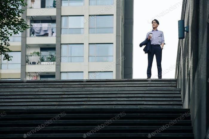 Confident ambitious Asian businessman