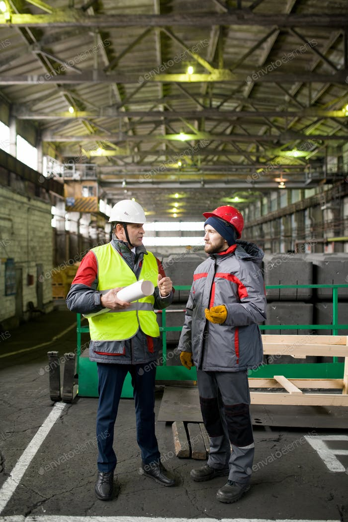 Two Workers Discussing Production