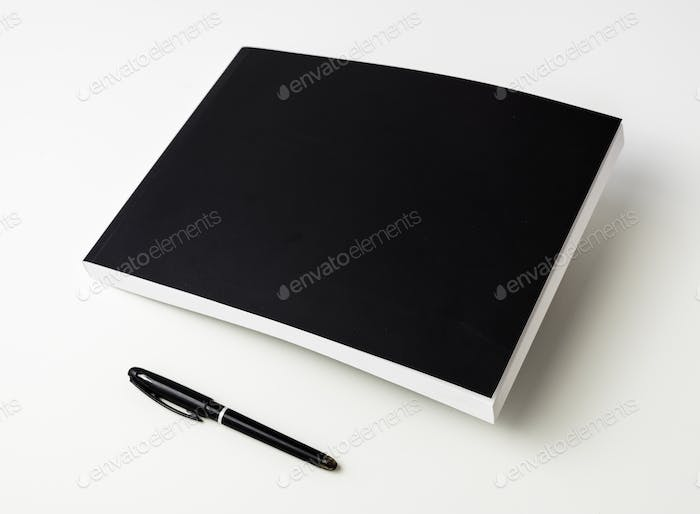 Closeup of black notebook isolated on white