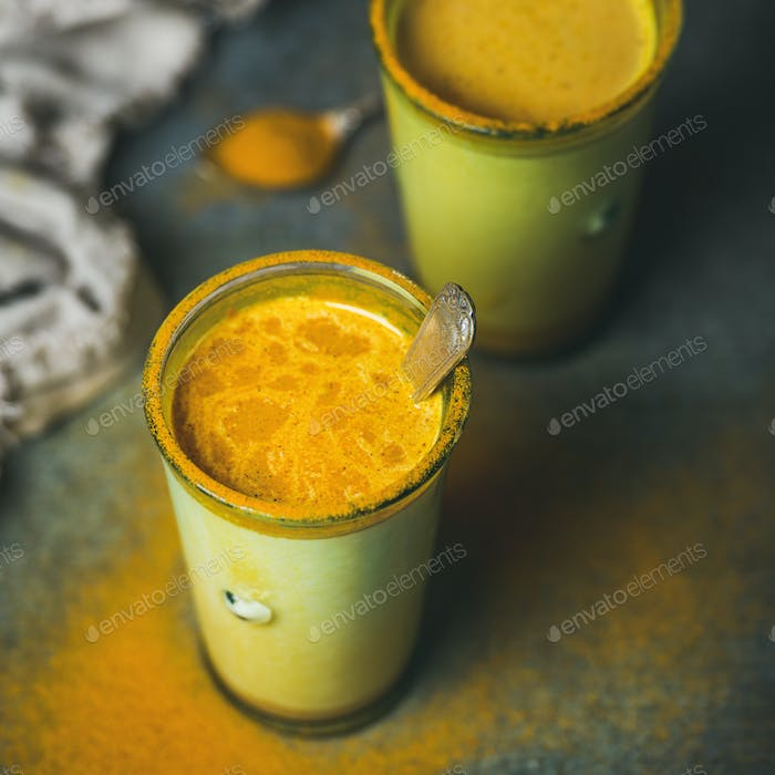 Golden milk with turmeric powder, natural cold fighting drink