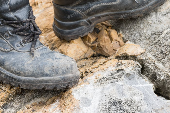 Trekking leather boot on the rock