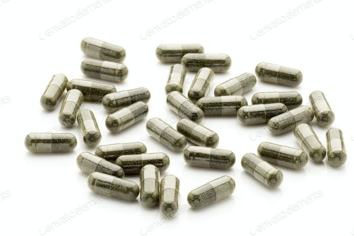 Homeopathic pills,  alternative medicine. On a white background.
