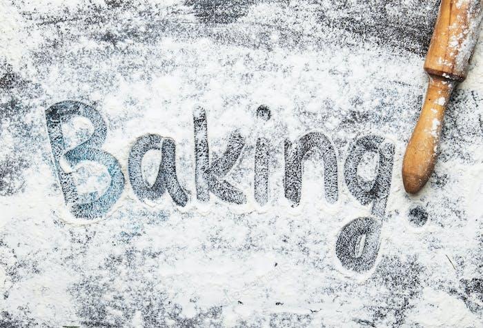 white flour sprinkled on dark table