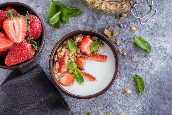 Breakfast with yogurt, granola of muesli and strawberries. Healthy Vegan Clean Diet Food Concept