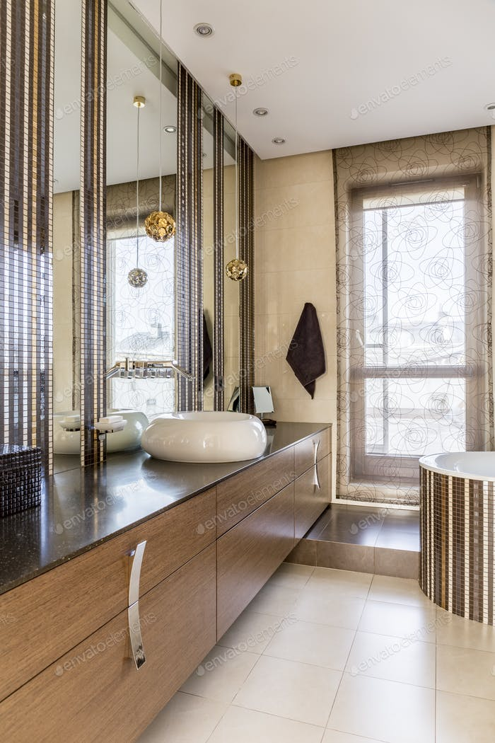 Luxurious bathroom with huge mirror