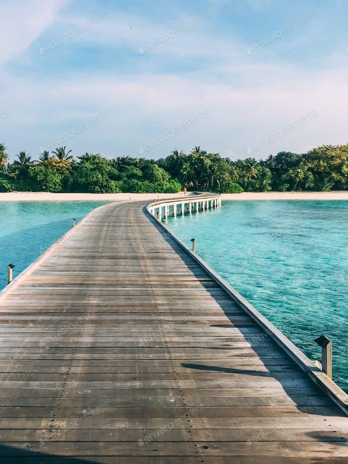 Maldives island luxury resort wooden pier