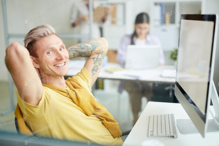 Contemporary Man Chilling at Workplace