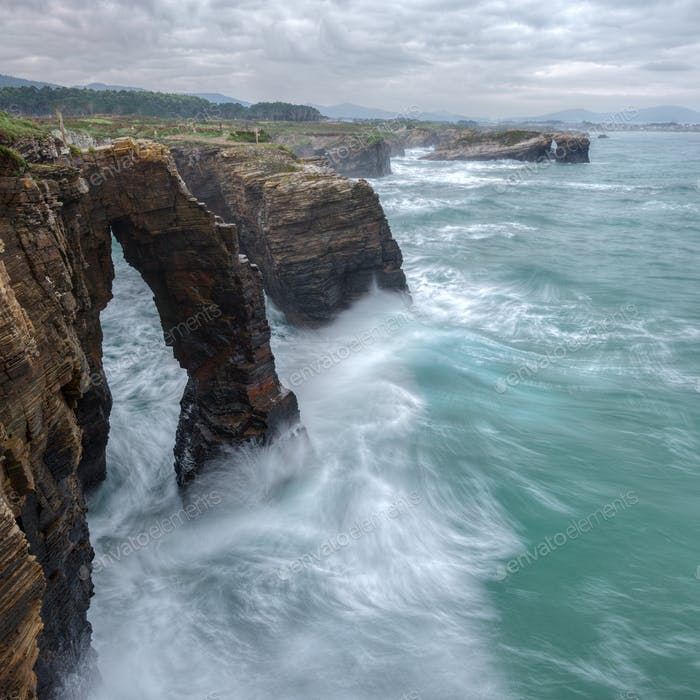 Large waves hit the arches of As Catedrais beach