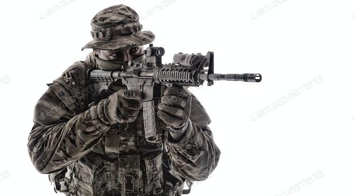 Army infantryman aiming service rifle studio shoot