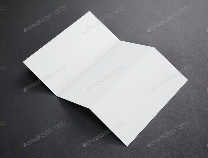 Blank white tri folded booklet mockup on dark background. 3d rendering.