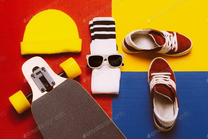 Stylish Set skateboarder. Sneakers, socks, skateboard. Eyeglasse