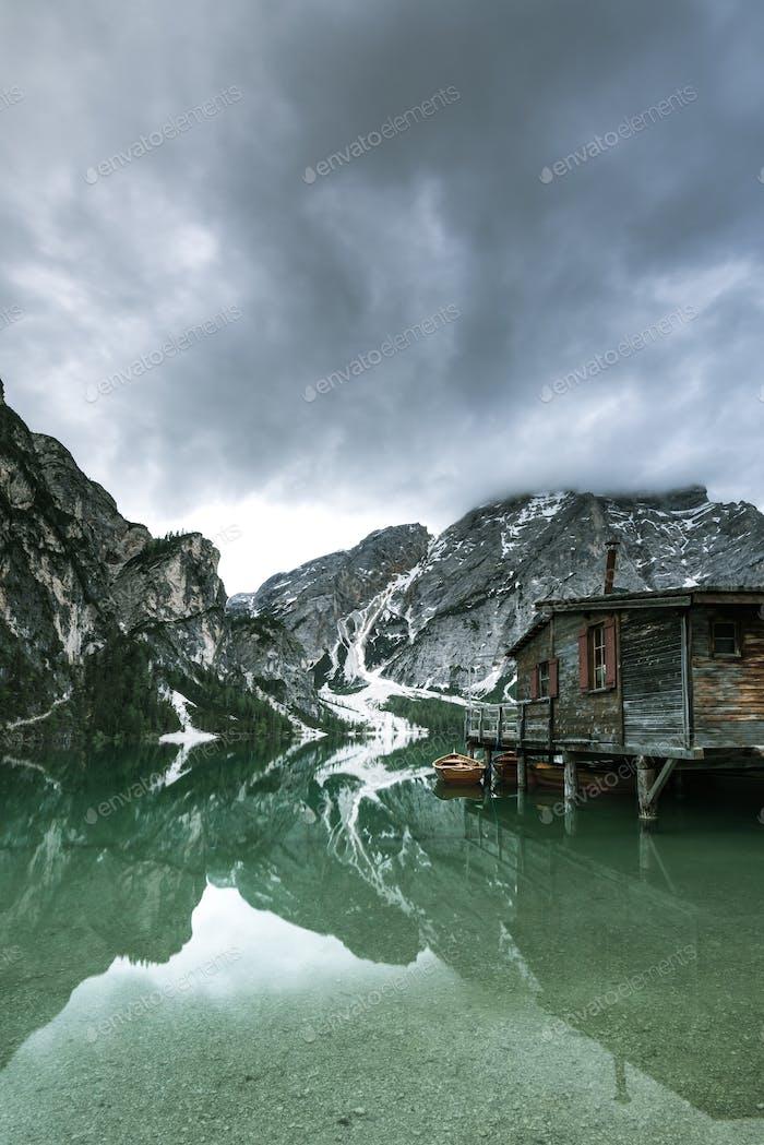 Moody image of Pragser Wildsee or Braies Lake in Italy.