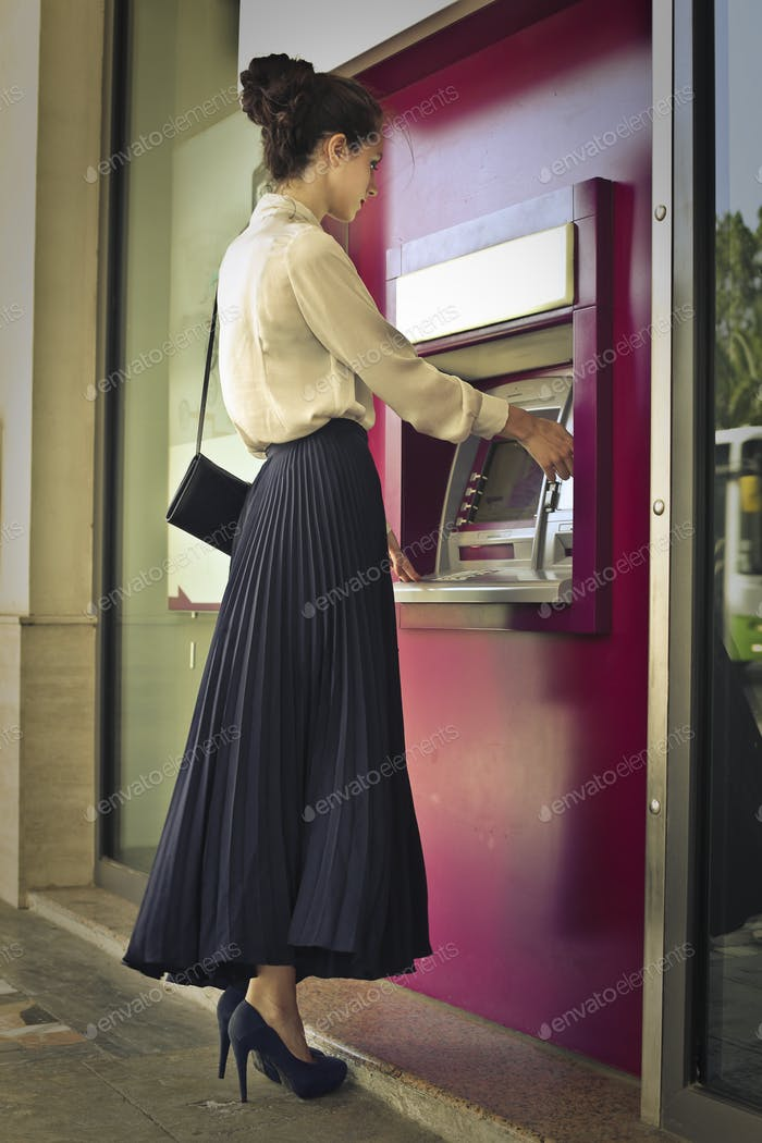 Fashionable woman doing a withdrawal