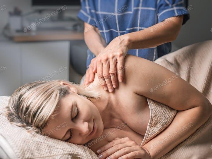 A woman receiving massage