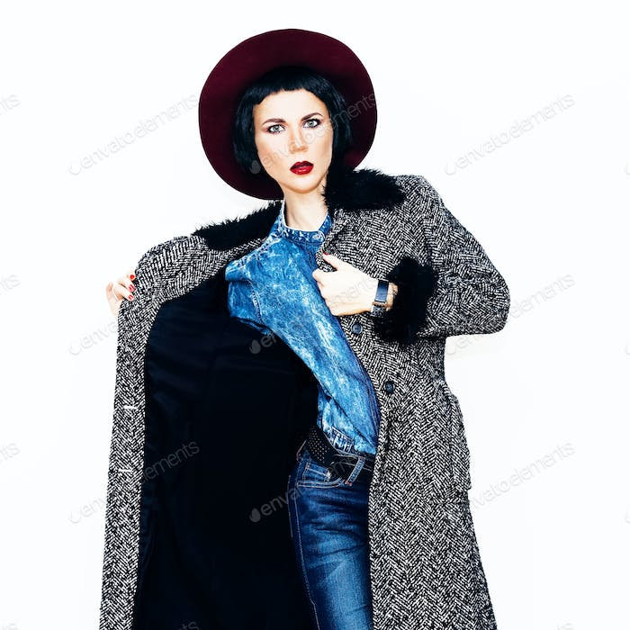 Glamorous fashion model in coat and stylish jeans clothes. Fashi