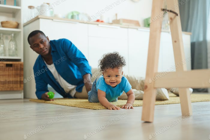 Cute Baby Crawling on Floor