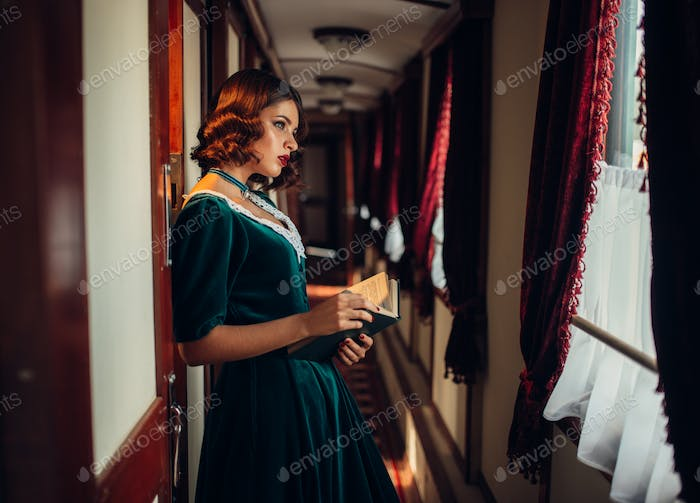Old-fashioned woman travels, retro train