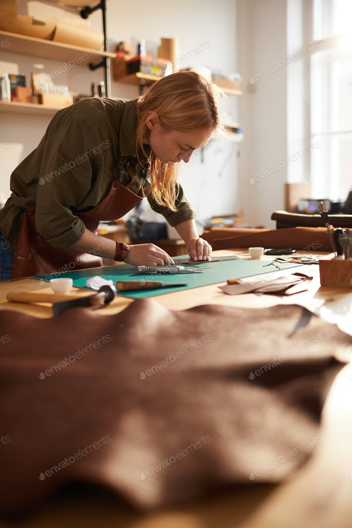 Female Artisan Working in Sunlit Shop