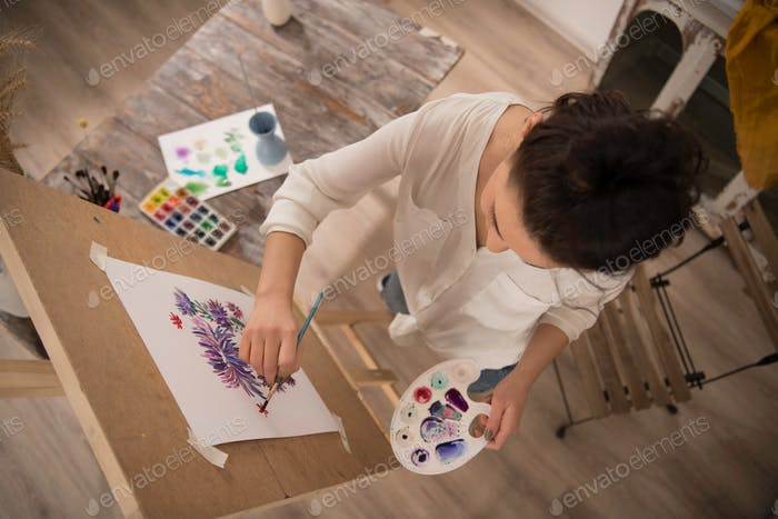 high angle view of  female artist working on her new picture