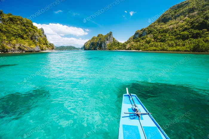 Trip tourist boat in blue shallow water lagoon. Discover exploring unique nature, journey to