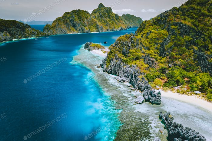 Aerial view of jutted lime stone cliff karst mountains on island tour exploration tour of