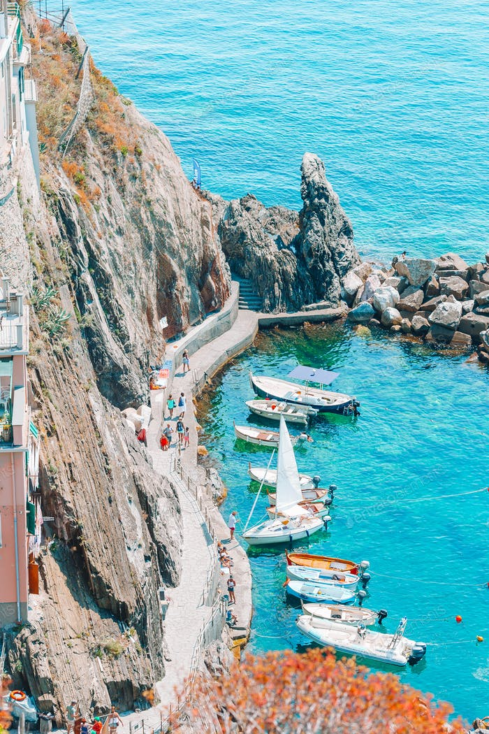 Beautiful cozy bay with boats and clear turquoise water in Italy, Europe