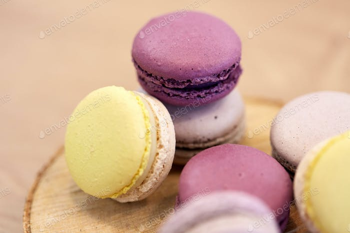 close up of different macarons on wooden stand