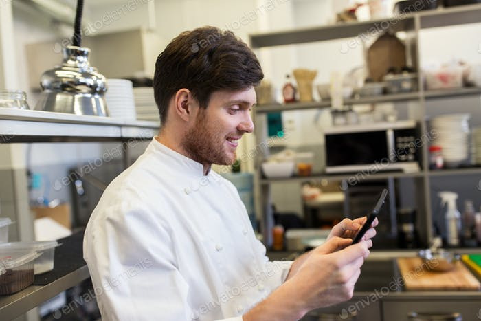 chef cook with tablet pc at restaurant kitchen
