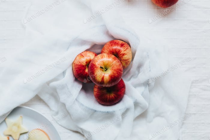 Red Apples in Bowl on Table with White Tablecloth