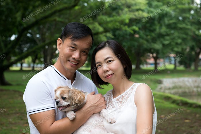 Asian lovely couple with shih tzu dog