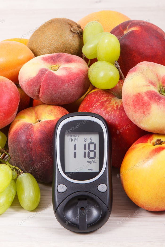 Glucose meter with result of measurement sugar level and healthy food as source vitamins