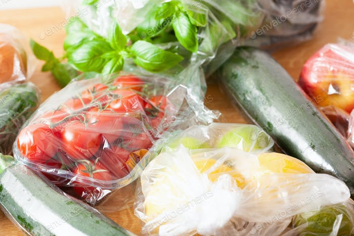 single use plastic waste issue. fruits and vegetables in plastic bags