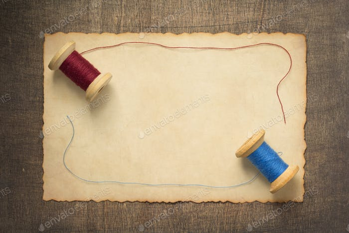 sewing thread on wooden table